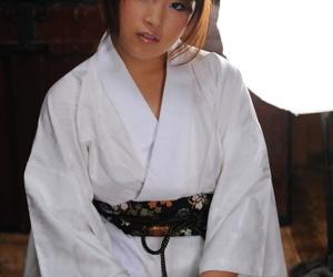 Innocent Japanese babe Nene Nagasawa posing in her lovely kimono