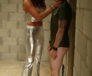 Strong woman in chrome clothing Kym Wilde dominates over short guy Brandon