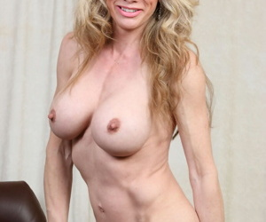 Older mature blonde in glasses and stockings exposing big tits & rubbing pussy