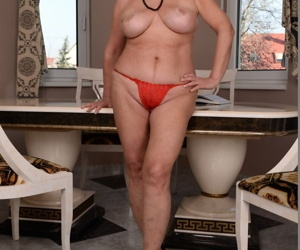Brunette big titted granny Sally G strips and show her swollen old cunt