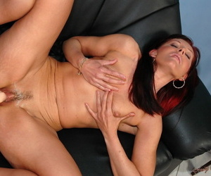 Mature woman Doreen and younger dude having amazing sex on the couch