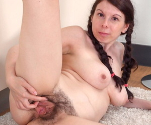 Brunette amateur Emily Winters shows off her really hairy pussy in pigtails