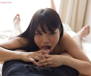 Young Japanese beauty licks the cum from her fingers after a hnadjob