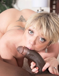 Short haired mature lady Dee Williams has sex with her black lover