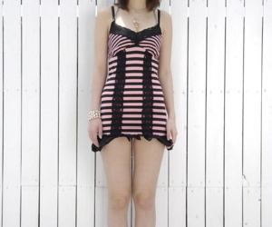 Cute Japanese Mari Sasaki removes lace panties to flash hairy pussy upskirt