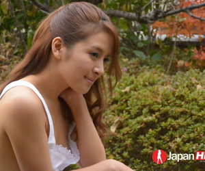 Gorgeous young Asian Nana Ninomiya poses erotically outdoors & by the window