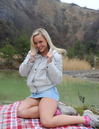 Sweet teen girl fingers her pussy on a chilly day in the mountains