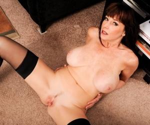 Hot mature lady Karen Kougar unleashes her nice melons a as she undresses