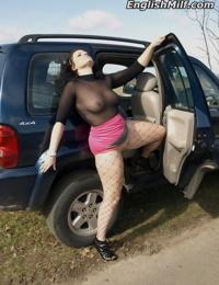 Fatty mature MILF Daniella English flashes naked upskirt in fishnet outdoors
