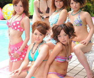 Sweet Japanese girlfriends in sexy swimsuits flaunt their beauty poolside