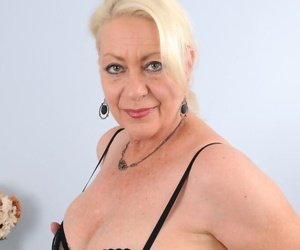 Mature housewife Angelique in black lace lingerie spreading pussy for closeup