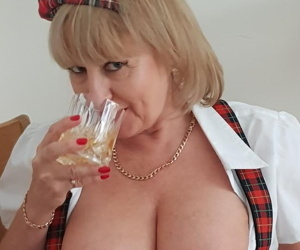 Mature amateur sucks a cock after flashing tits and twat in schoolgirl clothes