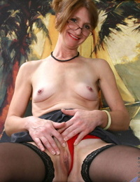 Classy mature lady uncovers her small tits and then her pussy too