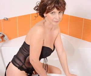 Hot mature woman slips off lingerie before masturbating in the bathtub