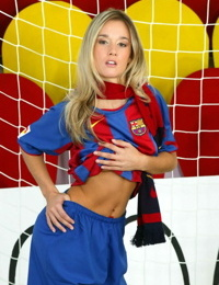 Petite teen Jana H shows her firm tits and tight ass in soccer net