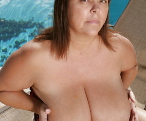 Mature fatty babe Josie Juggsy feels her boobs and toys pussy