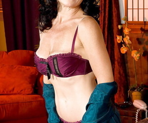 Mature babe Karen Kougar denudes her tits from lingerie and welcomes two cocks