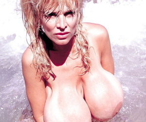 Chesty older blonde Busty Dusty spreading hairy twat outdoors on beach