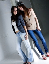 Teen girls Carly T and Rebekah strip off ripped denim jeans to model nude