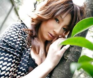Asian babe Reina Mizuki showcasing her petite fanny and hairy muff