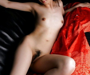 Lusty asian babe with hairy cunt uncovering her tiny curves