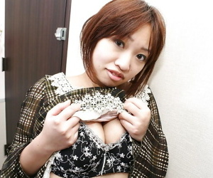 Asian MILF Rika Okabe undressing and demonstrating her twat in close up