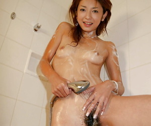 Slim asian babe stripping off her clothes and taking a shower
