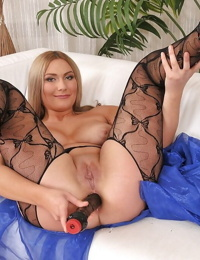 Curvy MILF on high heels masturbating her pussy and her asshole