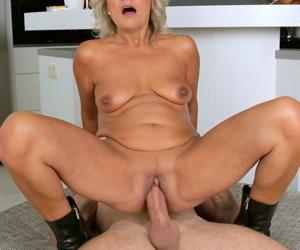Blonde older slut Sherry D sucking younger man cock & fucking on top