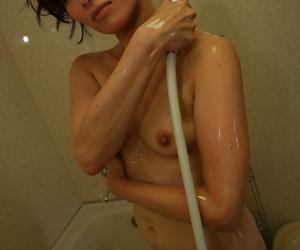 Svelte asian MILF with perky titties Chieko Kitani taking shower
