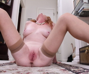 Awesome mature redhead in stockings Veronica showing her ass
