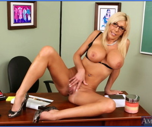 Mature teacher in glasses Misty Vonage revealing booming tits and booty
