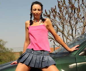Skinny mature brunette unveiling tiny breasts outdoors in skirt
