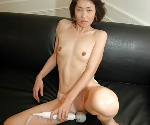 Graceful asian MILF stripping down and showcasing her honey pot