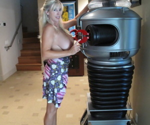 Mature wife with big tits poses on high heels and fondles her melons