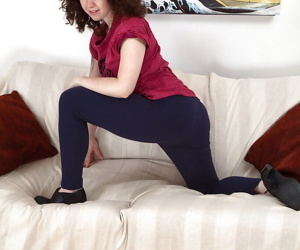 Mature chick Candy takes off her yoga pants and reveals her horny hairy pussy
