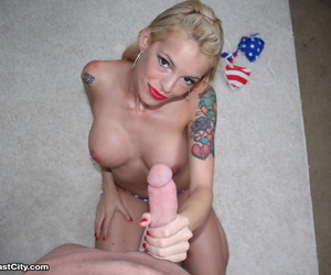 Older blonde with tattoos Bella Ink removes USA themed bikini during a handjob
