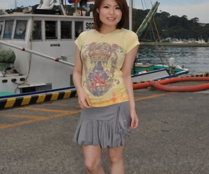 Young Japanese girl Miki Uemura poses on non nude in a skirt on a dock