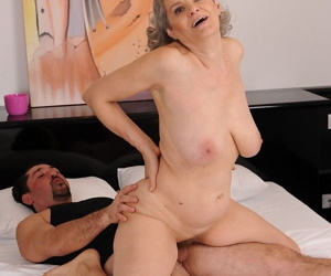 Granny with big natural tits Aliz gets banged by a horny younger guy