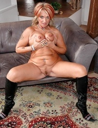 Big titted granny poses in sexy boots and spreading her wet cunt