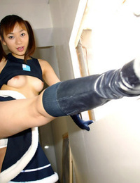 Seductive asian cheerleader exposing her lil\' tits and wooly pussy