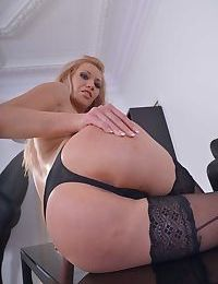 Russian solo girl Lindsey Olsen shows off her bald pussy in black stockings