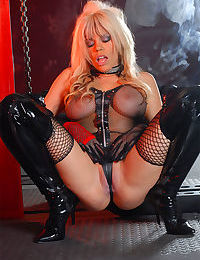 Huge titted hot Asian fetish girl posing in sheer lingerie & boots with whip