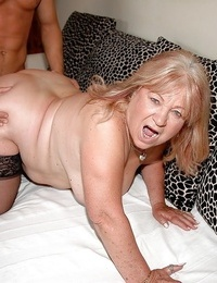 Round granny in stockings gives a blowjob and gets nailed by a younger stud