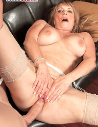 Hot grandmother Lexi McCain tempts a younger man in her undergarments and hose