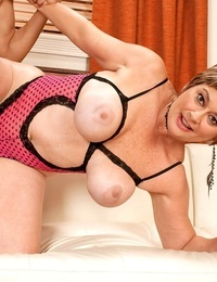 Older woman with short hair helps a youthful endowed with his cock problems