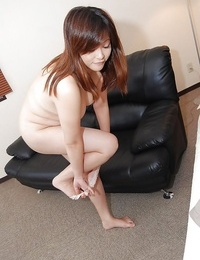 Round asian Mummy Chisako Nimura strips down and gets her clit stimulated