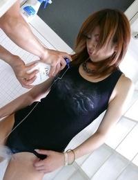 Japanese lady Yuu Mizuki wets her cunt while wearing a dark-hued bodysuit