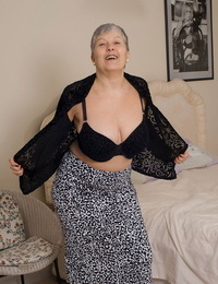 Grey haired gran from the UK takes off to her silk underwear and nylons