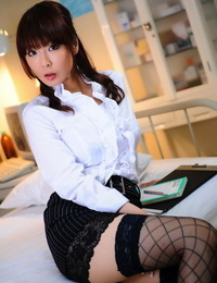 Totally dressed Japanese chick reveals thighs in fishnets and micro-skirt